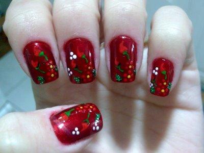 Unhas vermelhas com decoração ficam lindas (Foto: Divulgação)
