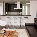 A cozinha conjugada à sala existe graças a integração de ambientes