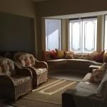 Sofá em alvenaria para área da janela