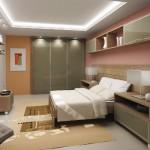Prático e sofisticado, o quarto oferece um ambiente confortável para o casal