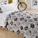Roupa de cama inspirada na estampa de jornal.