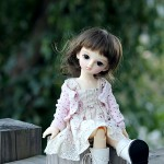 Boneca delicada com estilo angelical