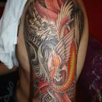 Tatuagem de Dragão colorida no braço