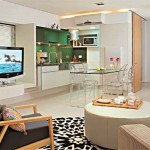 Nesse ambiente a sala de estar se integra com a cozinha e sala de janta harmonizando o ambiente.
