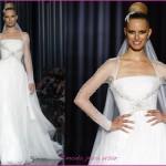 Vestido de noiva com um estilo de poncho rendado nos braços.