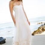 O vestido da noiva deve estar em harmonia com a atmosfera praiana. (Foto:Divulgação)