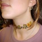 Tatuagem de flores no pescoço. (Foto:Divulgação)