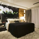 As paredes escuras podem ser mescladas com tons mais claros no quarto (Foto: Divulgação)