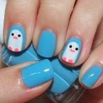 Unhas decoradas com pinguins. (Foto:Divulgação)