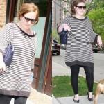 Adele usando blusa larguinha e calça legging justa. (Foto:Divulgação)