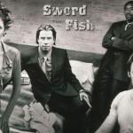 """John Travolta, Hale Berry e Hugh Jackman participaram de """"SwordFish - A senha"""" (Foto: Divulgação)"""