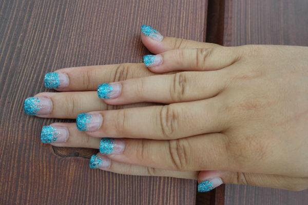 As unhas decoradas fazem parte do figurino (Foto: Divulgação)