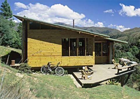 Casa de madeira amarelada (Foto: Casa Abril)