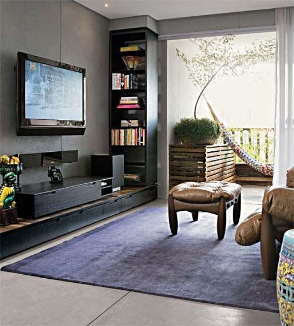 Sala de estar com cimento queimado. (Foto: Reprodução/Portal Casa)
