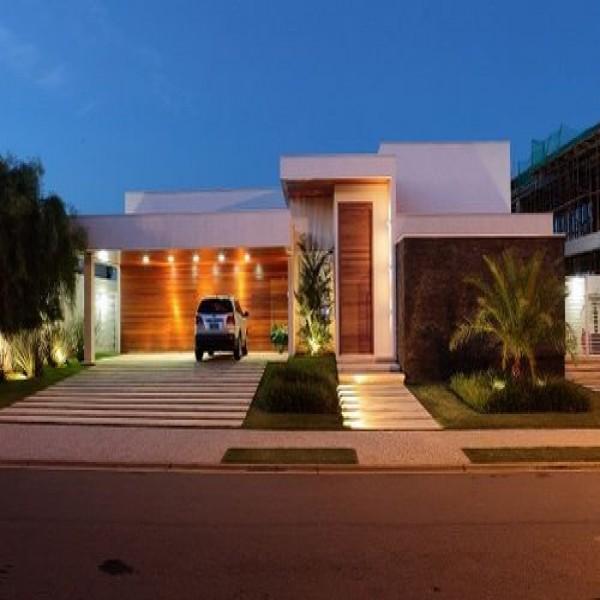 Casas com fachadas e garagem