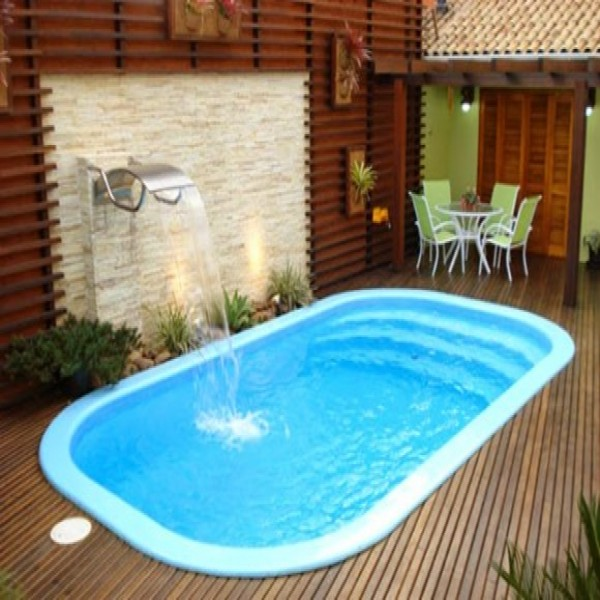 10 modelos de piscinas para casas pequenas for Casas con piscina interior fotos